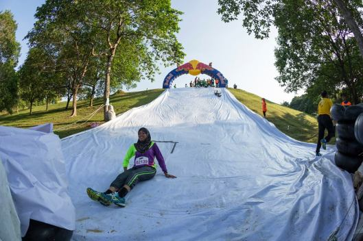 sliding down, photo from fb Putrajaya Deuter Run