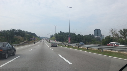 The Malaysia flag fly at half-mast along the road, on my way to office this morning..